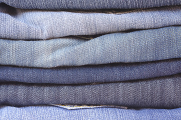 close up stack of folded jeans horizontal