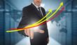 Businessman touching red and yellow growth lines with world map