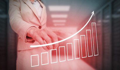 Businesswoman touching red bar chart and arrow graphic
