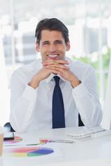 Smiling businessman posing crossing fingers