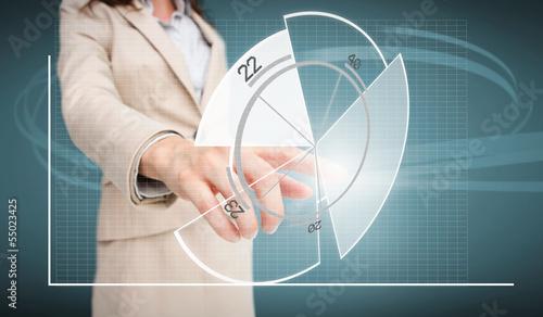 Businesswoman touching futuristic pie chart interface