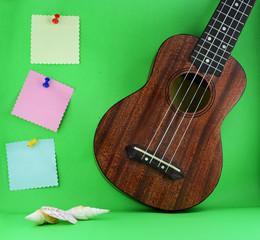 ukulele and sticky paper note