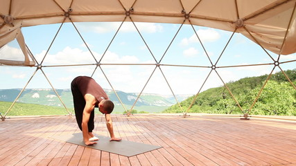 Yoga man Handstand pose in mountain training center