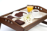 Orange juice, cookies and cup of coffee over wooden tray poster