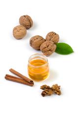 Walnuts, honey and cinnamon on a white background