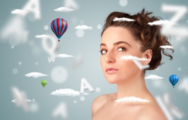 Beautiful young woman with wellness and healthcare clouds