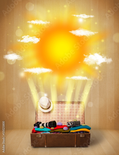 Summer bright sun with clouds and tourist bag