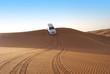 Zdjęcia na płótnie, fototapety, obrazy : Dune riding in arabian desert