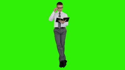 Young businessman writing on a clipboard, Green Screen