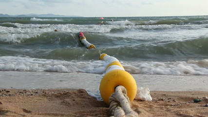 yellow and white buoys in the sea