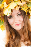 Beautiful fall woman. Portrait of girl with autumn wreath