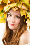Beautiful fall woman. Portrait of girl with  wreath of leaves