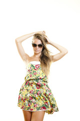 Young beautiful woman with fashion dress and sunglasses
