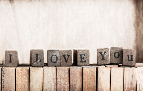 "Wood cube make message ""i love you"""