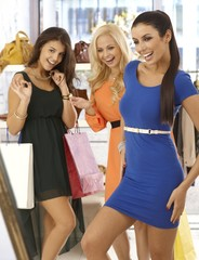 Happy girls at clothes store