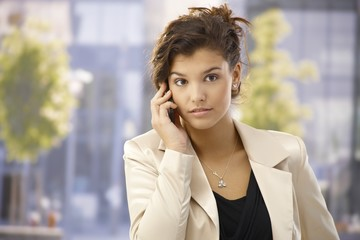 Outdoor portrait of businesswoman with mobile
