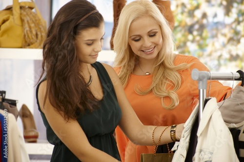 Pretty girls shopping at clothes store