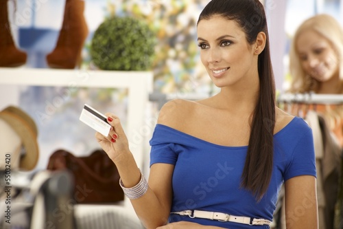 Beautiful woman paying by credit card