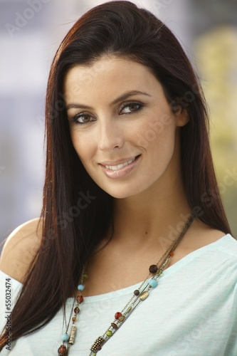 Closeup portrait of beautiful young woman smiling