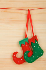 Handmade Christmas decorations: felt elf shoes over wood