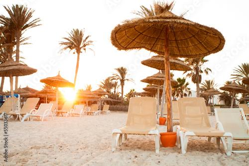 Fotobehang Tunesië Sandy beach with deckchairs