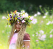 girl in a beautiful flower wreath.