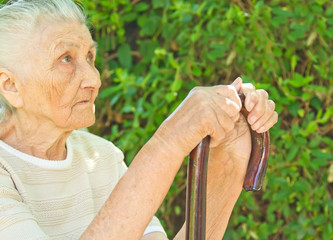 senior woman sitting in the park