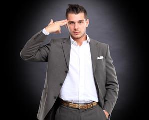 Portrait of elegant businessman touching his temple