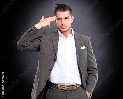 Portrait of elegant businessman touching his temple