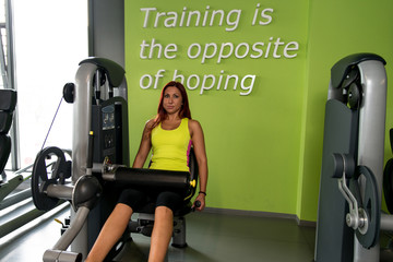 Young Woman on Leg Exercise Machine