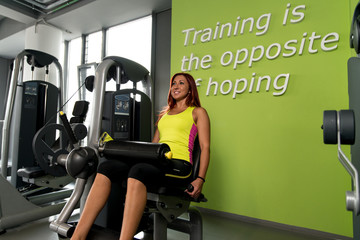 Sporty woman exercising in a fitness center.