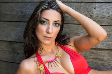 Woman in red bikini with necklace