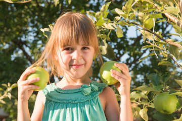 Happiness girl picking an apple