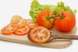 Closeup of slice tomato on Wooden Cutting Board