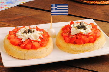 Greek dakos, Cretan recipe with bread, tomato, feta and oregano