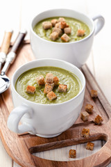 Vegetarian green pea soup with croutons