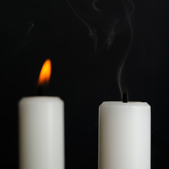 Candle with Smoke and Burning Candle