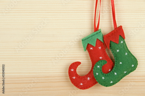 Handmade Christmas decorations: felt elf shoes over wood