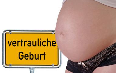 schwangere Frau mit Schild - vertrauliche Geburt