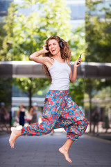 Young urban woman jumping