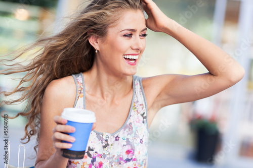Woman outdoors with coffee