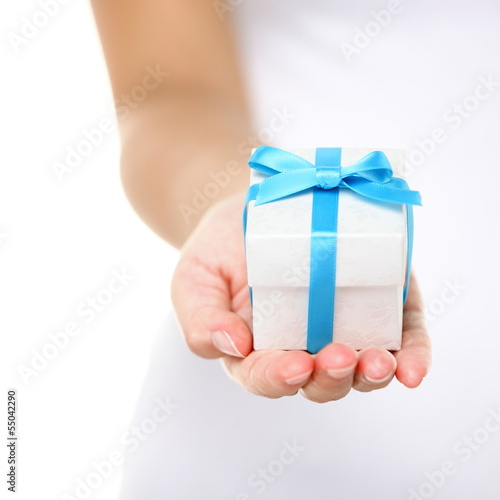 Gift box / present or christmas gift hand close up