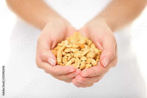 Cashew nuts - woman holding salty cashew nuts