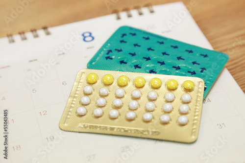 birth control pills on a calendar