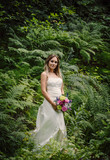 bride in a green forest