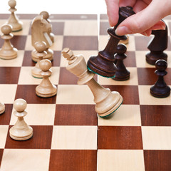 black king overturns white king in chess game