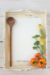 Fresh organic vegetables with paper for notes
