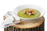 Green pea cream soup with toasts