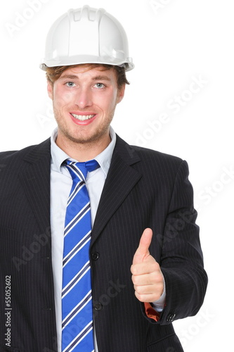 Engineer or architect in suit successful thumbs up