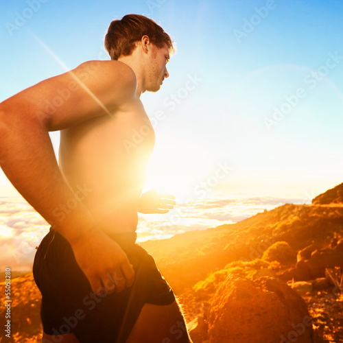 Running people - male runner at sunset in mountain